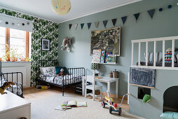 Twin beds, raised platform and grey-blue walls in siblings' bedroom
