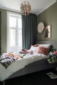 Bedroom with olive-green walls