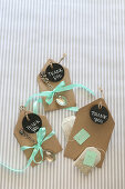 Round tags and tiny silver spoons decorating small envelopes of tea