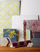 Different floor coverings in gray, yellow and pink