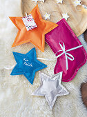 Star and stocking shaped bags sewn from wrapping paper