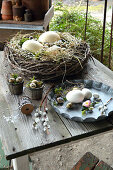 Wreath Of Branches As Easter Basket With Eggs