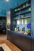 Modern fitted kitchen in petrol blue and charcoal