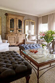Ottoman and antique cabinet in classic living room