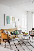 Ochre-yellow sofa and diamond-patterned rug in living room