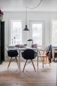 Round table and black classic chairs