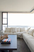 Cream sofa in front of corner window with panoramic view