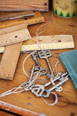 Various wooden rulers and vintage keys on table