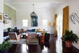 Living room in natural tones with dark wooden floor