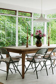 Vintage metal chairs around farmhouse table
