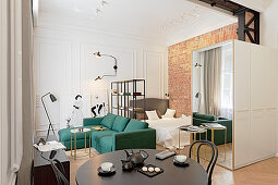 Sleeping, living and dining areas in small apartment