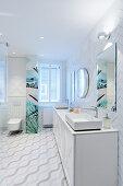 Tiles laid in herringbone pattern in white bathroom