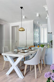 Upholstered chairs at dining table next to open-plan kitchen