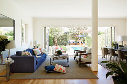 Modern open living room with an open window to the garden