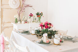 Flower arrangements on table set for Easter