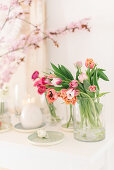 Glass vase of tulips on Easter table