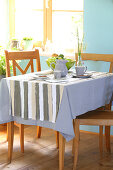 DIY tablecloth with strips of fabric