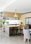 Bright, open kitchen with counter and polished concrete floor