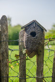 Nesting box made of sisal on the fence