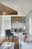 Interior in natural shades with bedroom on gallery in holiday home
