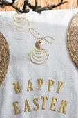 Easter greeting in gold letters on table