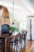 Dining area in front of a rustic fireplace