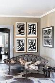 Vintage metal bench in corner of room with artworks on grey-brown walls