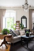 Dark, vintage-style furniture in living room of period building