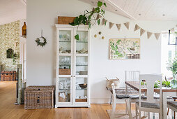 Display case in dining area of open-plan interior