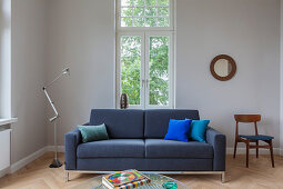 Sofa, standard lamp and chair in living room