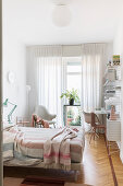 Bright bedroom in white and nude tones