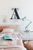 Poster of letter A and number 7 in bedroom decorated in pale shades