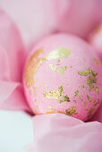 Pink eggs with gold leaf on tissue paper
