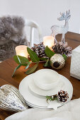 White crockery and Christmas decorations on wooden table