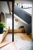 Elegant staircase with wooden elements and gray banisters