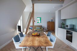 Simple fitted kitchen and dining area in open-plan interior