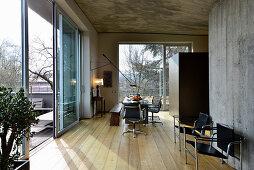 Masculine designer interior with concrete walls and wooden floor