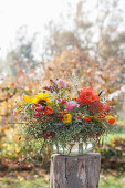 Autumn bouquet in glass bowl