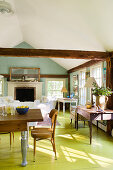 Country-house-style interior with lime-green floor