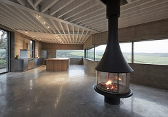 Free-standing fireplace in minimalist architect-designed house