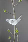 Tiny, delicate bird made from pallet band hung from spring bouquet