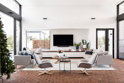 Modern living room with light gray upholstered furniture