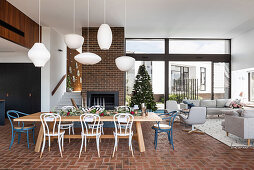 Large open living room with brick floor and laid table