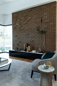 Brick wall with cantilevered stones in the living room