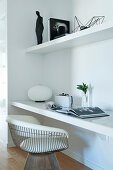 Designer chair at the built-in desk in the wall niche