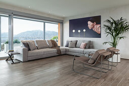 Minimalist interior in earthy shades with glass wall