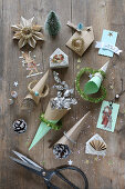 Handcrafted, paper Christmas decorations, cones of sweets, pictures of roses, scissors and glitter