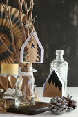 Handcrafted paper Christmas decorations: small houses, fir tree and for forest