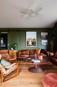 Living room in brown and green with leather sofas and leather armchairs