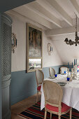 Silverware candlesticks on dining table with corner cabinet with 18th century French trumeau mirror